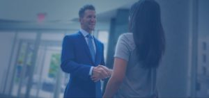 Judd Shaw shaking hands with happy client