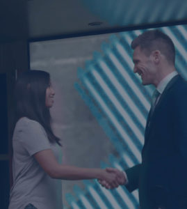 Judd Shaw shaking hands with a happy client