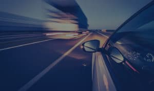 image of a car driving down the interstate